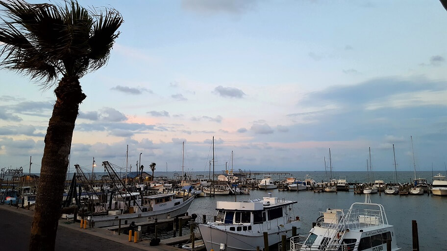 Sunset view of Fulton TX harbor from upstairs deck at Charlotte Plummers Seafare restaurant (photo by Sheila Scarborough)
