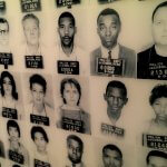 Wall of photos of people arrested for civil rights issues National Civil Rights Museum Memphis (photo by Sheila Scarborough)