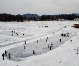 Things to do in Lake Placid winter fun sports on Mirror Lake seen from room balcony at Golden Arrow Lakeside Resort (photo by Sheila Scarborough)