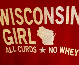 Main Street towns and cities take pride in their uniqueness - a Wisconsin Girl Tshirt at The Brat Stop in Kenosha WI (photo by Sheila Scarborough)