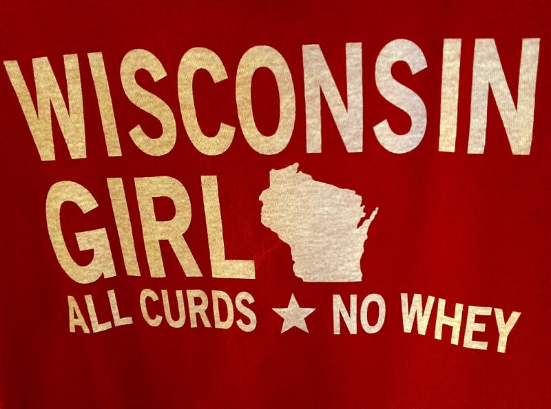 Main Street towns and cities take pride in individuality: a Wisconsin Girl Tshirt at The Brat Stop in Kenosha WI (photo by Sheila Scarborough)