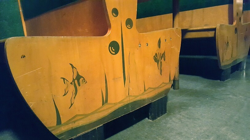 Fish details on wooden booth seats Surf Ballroom Clear Lake Iowa (photo by Sheila Scarborough)
