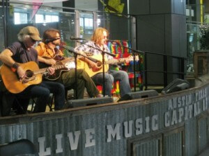 Austin airport live music with David Holt (photo by Sheila Scarborough)