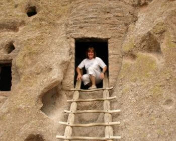 Sheila at Bandelier National Monument cave dwelling entrance (Scarborough photo)