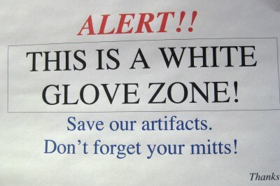 cosmosphere-white-glove-alert-sign