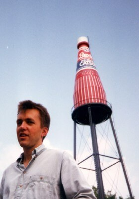 Jamie with the World's Largest Catsup Bottle, in Collinsville IL (photo courtesy Perseus Books and Avalon Travel Publishing)
