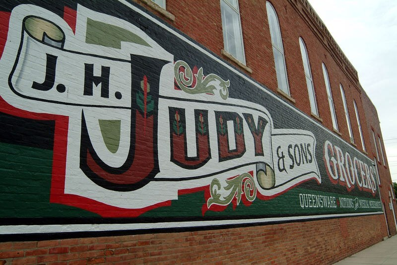 Close up of JH Judy grocer's sign, Atlanta IL (courtesy Wikimedia Commons)