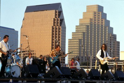 Musicians in front of the Austin skyline (courtesy Austin CVB)