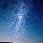 dark skies with shooting star