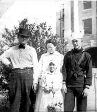 My Grandfather Scarborough in his WWI Navy uniform, with family (his younger sister is dressed for Red Cross work)
