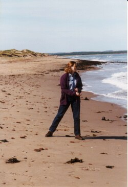 The author skipping stones on the Prince Edward Island seashore