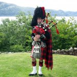 scotland highland piper in landscape