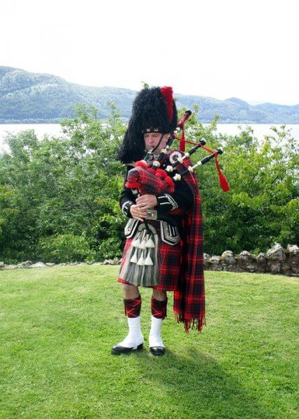 scotland piper in landscape