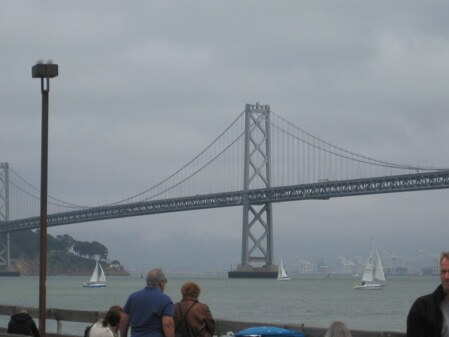 A classic view of foggy San Francisco through the Bay Bridge, from the farmer's market at the Ferry Building.