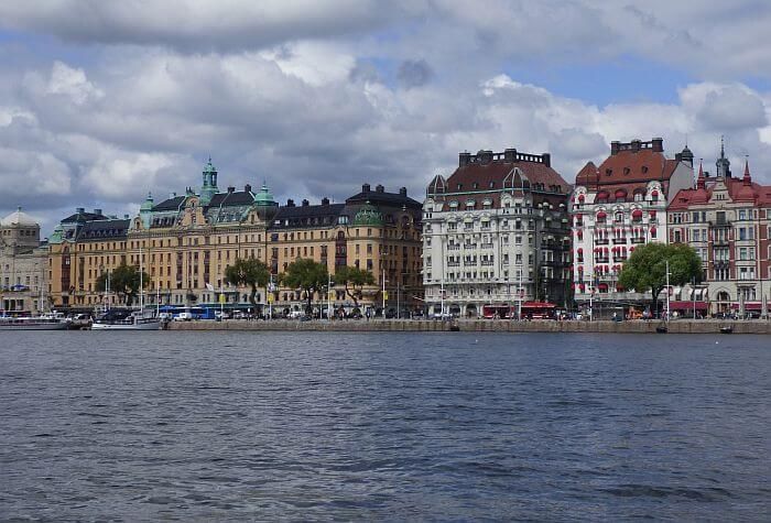 Historic buildings of Stockholm on the water in the summer